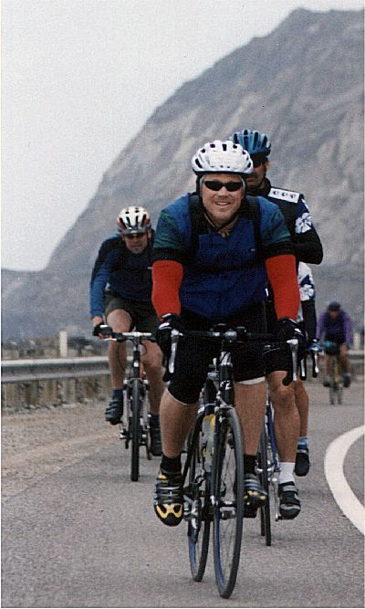 RDM riding along the highway on the Calfornia AIDSRide 2002